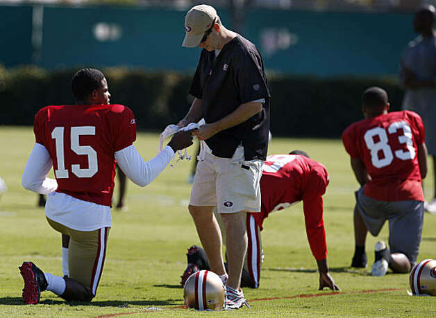 A team assistant helps San Francisco 49ers wide receiver Michael Crabtree select a chinstrap during practice in Santa Clara on Wednesday. Photo: Paul Chinn, The Chronicle