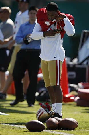 Newly signed San Francisco 49ers wide receiver Michael Crabtree adjusts his equipment during his first practice in Santa Clara, Calif., on Wednesday, Oct. 7, 2009. Photo: Paul Chinn, The Chronicle