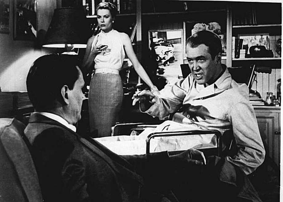 "FILE---Jimmy Stewart right, Grace Kelly and Wendell Corey appear in a scene from ""Rear Window"", a film directed by Alfred Hitchcock in 1954. Jimmy Stewart, the lanky, slow-talking actor who embodied American decency and moral courage in such movies as ``Mr. Smith Goes to Washington'' and ``It's a Wonderful Life,'' died Wednesday at 89. Daily Variety columnist Army Archerd said Stewart's son told him the star died at his Beverly Hills home. (AP PHOTO/FILE)  ALSO RAN 03/28/04 Photo: Handout, AP"