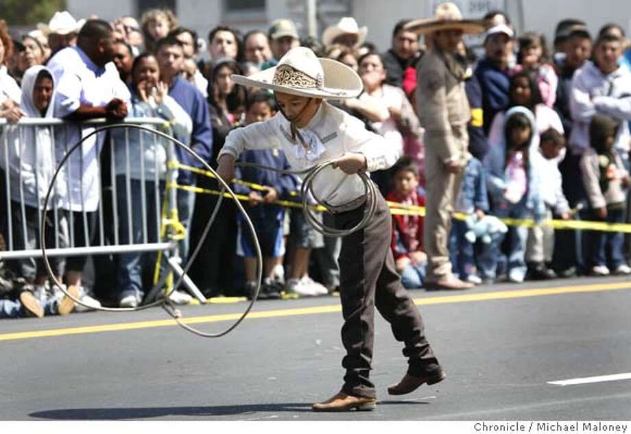 ###Live Caption:Nine year-old Victor Pulido of Dixon, Calif., shows off his roping skills as he performs at the Cinco de Mayo Festival along 23rd Street in Richmond, Calif. on May 4, 2008.  Photo by Michael Maloney / San Francisco Chronicle###Caption History:Nine year-old Victor Pulido of Dixon, Calif., shows off his roping skills as he performs at the Cinco de Mayo Festival along 23rd Street in Richmond, Calif. on May 4, 2008.  Photo by Michael Maloney / San Francisco Chronicle###Notes:###Special Instructions:MANDATORY CREDIT FOR PHOTOG AND SAN FRANCISCO CHRONICLE/NO SALES-MAGS OUT Photo: Michael Maloney