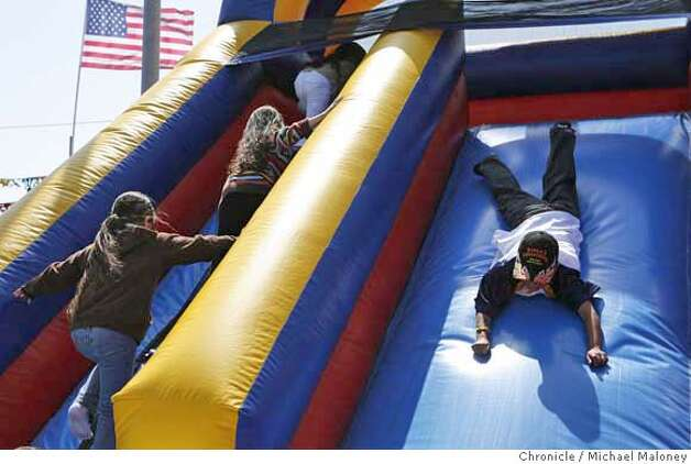 ###Live Caption:Kids play on the inflatable slide set at the Cinco de Mayo Festival along 23rd Street in Richmond, Calif. on May 4, 2008.  Photo by Michael Maloney / San Francisco Chronicle###Caption History:Kids play on the inflatable slide set at the Cinco de Mayo Festival along 23rd Street in Richmond, Calif. on May 4, 2008.  Photo by Michael Maloney / San Francisco Chronicle###Notes:###Special Instructions:MANDATORY CREDIT FOR PHOTOG AND SAN FRANCISCO CHRONICLE/NO SALES-MAGS OUT Photo: Michael Maloney