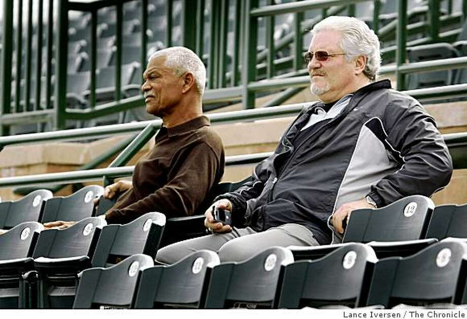 Giants' general manager Brian Sabean, right, sits in the stands at Scottsdale Stadium with his special assistant, Felipe Alou, left, during a spring training baseball workout in Scottsdale, Ariz. The San Francisco Giants pitchers and catchers took part in their first official team workout at Scottsdale Stadium Thursday morning as they get ready for the opening of the Cactus League opener.  By Lance Iversen/The San Francisco Chronicle Photo: Lance Iversen, The Chronicle