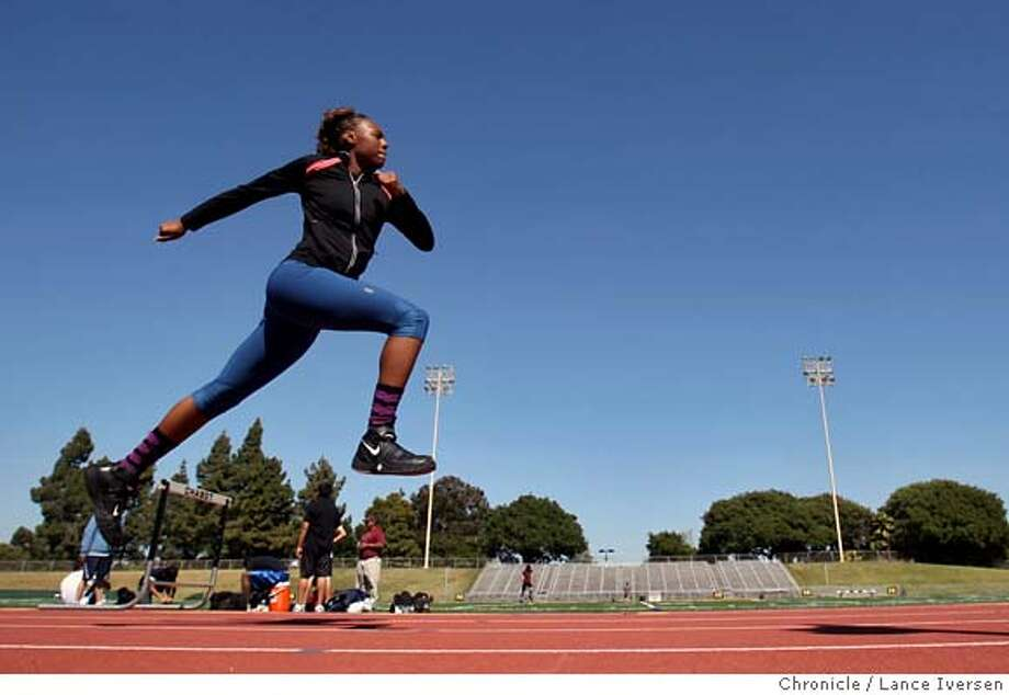 ###Live Caption:Olympic hopeful Alitta Boyd works on her jumping as she works out with her personal coach Sylvester Johnson at Chabot College Thursday May 1, 2008. Boyd is an elite three-sport athlete in an era when most athletes specialize in one sport. Boyd hopes to qualify for the Olympics this summer in the triple jump. Photographed in Hayward Calif, Photo By Lance Iversen / San Francisco Chronicle###Caption History:Olympic hopeful Alitta Boyd works on her jumping as she works out with her personal coach Sylvester Johnson at Chabot College Thursday May 1, 2008. Boyd is an elite three-sport athlete in an era when most athletes specialize in one sport. Boyd hopes to qualify for the Olympics this summer in the triple jump. Photographed in Hayward Calif, Photo By Lance Iversen / San Francisco Chronicle###Notes:Lance Iversen 415-2979395  CQ###Special Instructions:MANDATORY CREDIT PHOTOG AND SAN FRANCISCO CHRONICLE. Photo: LANCE IVERSEN