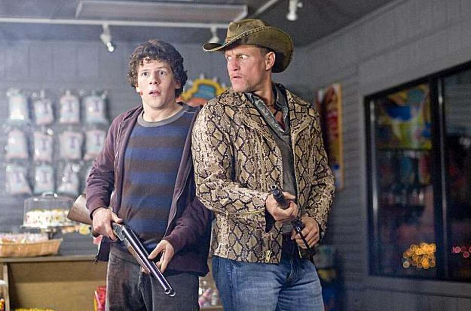 "In this film publicity image released  by Columbia Pictures, Jesse Eisenberg, left, and Woody Harrelson are shown in a scene from, ""Zombieland."" (AP Photo/Columbia Pictures, Greg Wilson) Photo: Glen Wilson, AP"