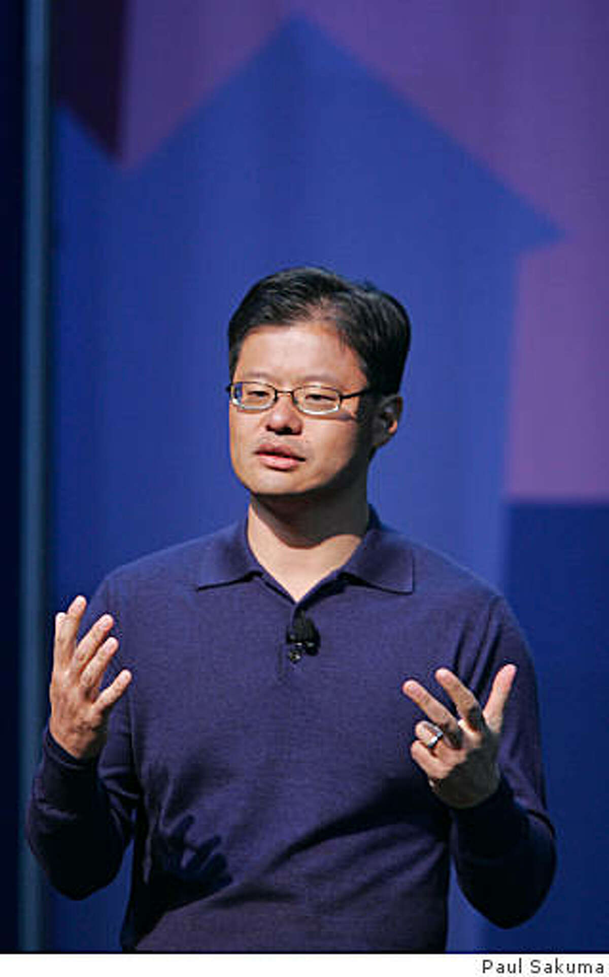 ** FILE ** Yahoo CEO Jerry Yang gives a keynote address at the Consumer Electronics Show (CES) in Las Vegas, in this Jan. 7, 2008 file photo. Yahoo Inc. Chief Executive Jerry Yang told employees Wednesday Feb. 6, 2008, that the struggling Internet pioneer is still examining ways to avoid a takeover by rival Microsoft Corp. (AP Photo/Paul Sakuma, file)