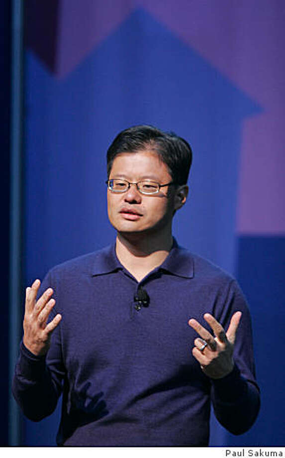 ** FILE ** Yahoo CEO Jerry Yang gives a keynote address at the Consumer Electronics Show (CES) in Las Vegas, in this Jan. 7, 2008 file photo. Yahoo Inc. Chief Executive Jerry Yang told employees Wednesday Feb. 6, 2008, that the struggling Internet pioneer is still examining ways to avoid a takeover by rival Microsoft Corp. (AP Photo/Paul Sakuma, file) Photo: Paul Sakuma, AP