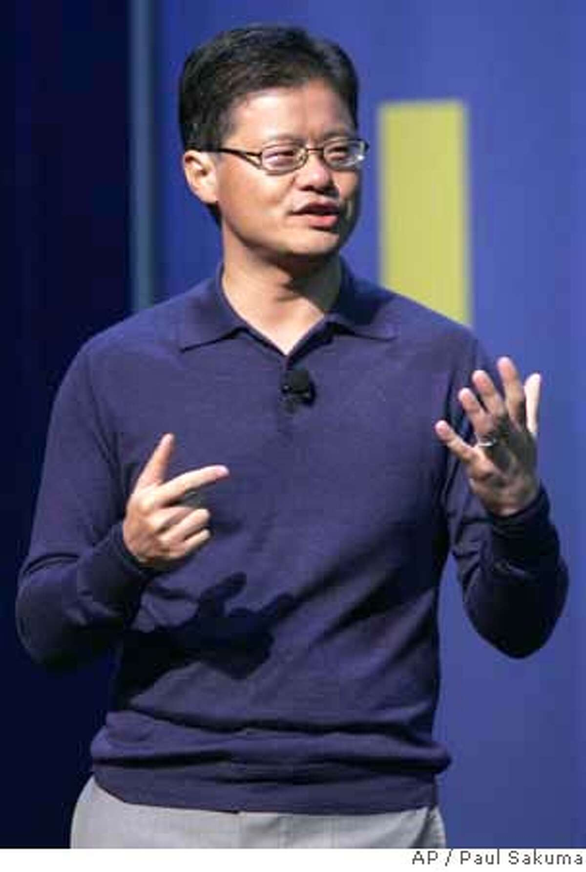 Yahoo CEO Jerry Yang gestures during his speech at the Consumer Electronics Show in Las Vegas, Jan. 6, 2008. Google Chief Executive Officer Eric Schmidt called Yang Friday to offer his help in repelling Microsoft, according to a report Sunday on The Wall Street Journal's Web site, which cited anonymous people familiar with the matter. (AP Photo/Paul Sakuma) JAN. 6, 2008 PHOTO. NOT A FILE.