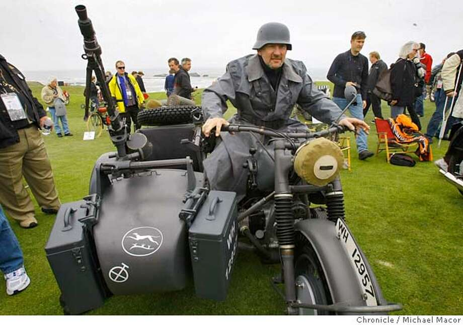 ###Live Caption:John Menefee aboard his 1942 BMW R 75 motorcycle gets into character as he shows off his bike during the 2008 Legend Of The Motorcycle in Half Moon Bay, Calif., on May 3, 2008. Menefee is from Tennessee and bought the bike at aution a year ago. Photo by Michael Macor/ San Francisco Chronicle###Caption History:John Menefee aboard his 1942 BMW R 75 motorcycle gets into character as he shows off his bike during the 2008 Legend Of The Motorcycle in Half Moon Bay, Calif., on May 3, 2008. Menefee is from Tennessee and bought the bike at aution a year ago. Photo by Michael Macor/ San Francisco Chronicle###Notes:Legend of the Motorcycle, Concours D'Elegance on the grounds of the Ritz Carlton Hotel in Half Moon Bay, Calif. on May 3, 2008.###Special Instructions:Mandatory credit for Photographer and San Francisco Chronicle No sales/ Magazines Out Photo: Michael Macor