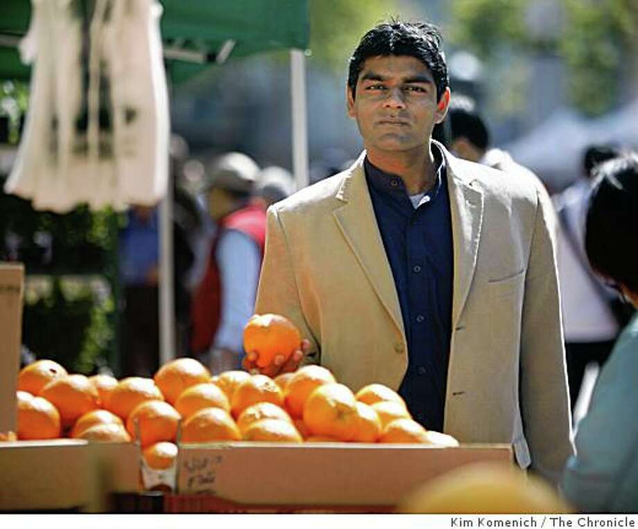 "UC Berkeley food policy analyst Dr. Raj Patel has written a new book called  ""Stuffed & Starved: The Hidden Battle for the World Food System"". A world food policy authority, has been asked to testify before the U.S. House of Representatives Financial Services Committee about the global food crisis and the role of the World Bank.He is photographed at the San Francisco Farmers' Market at Fulton adn Hyde Streets on Wednesday, May 7, 2008.                                                                                                                                                                                                                                                                                                                                                                                                                                                                                                                                                                                                                                                                                                                                                                                                                                                                                                                                                                                                                                                                                                                                Photo by Kim Komenich / San Francisco Chronicle Photo: Kim Komenich, The Chronicle"