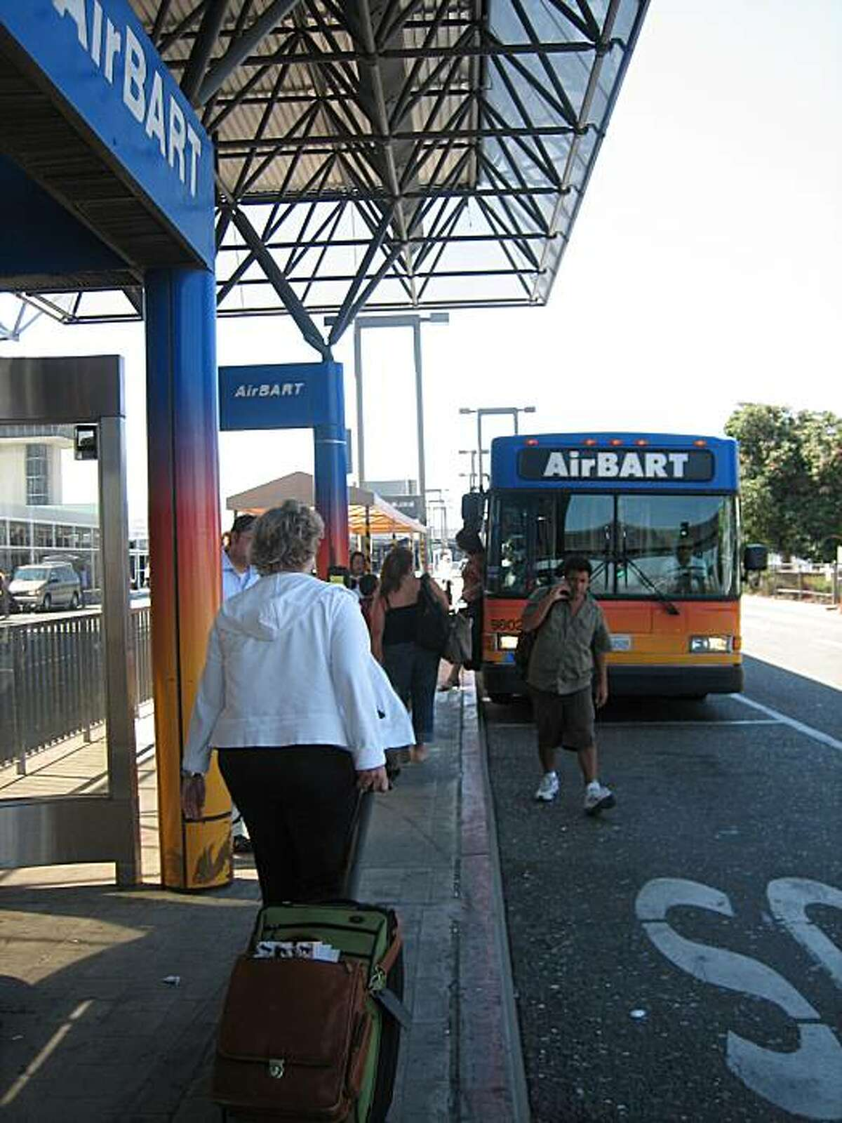 AirBart stops have been relocated, but the small signs do little to alert passengers waiting at old AirBart platforms.