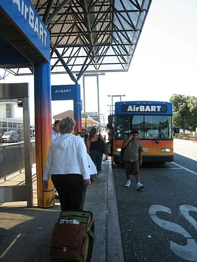AirBart stops have been relocated, but the small signs do little to alert passengers waiting at old AirBart platforms. Photo: Becky Bowman, The Chronicle