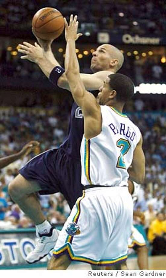 ###Live Caption:Dallas Maverick guard Jason Kidd shoots over New Orleans Hornets guard Jannero Pargo (R) during the second half of Game 5 of their NBA playoff series in New Orleans, Louisiana April 29, 2008. New Orleans won the game 99-94 advancing them into the second round of the playoffs. REUTERS/Sean Gardner (UNITED STATES)###Caption History:Dallas Maverick guard Jason Kidd shoots over New Orleans Hornets guard Jannero Pargo (R) during the second half of Game 5 of their NBA playoff series in New Orleans, Louisiana April 29, 2008. New Orleans won the game 99-94 advancing them into the second round of the playoffs. REUTERS/Sean Gardner (UNITED STATES)###Notes:Dallas Maverick guard Jason Kidd shoots over New Orleans Hornets guard Jannero Pargo during the second half of Game 5 of their NBA playoff series in New Orleans###Special Instructions:0 Photo: SEAN GARDNER