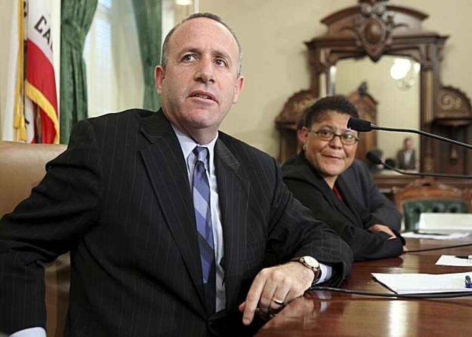 State Senate President Pro Tem Darrell Steinberg, D-Sacramento, left, responds to a question during a news conference held with Assembly Speaker Karen Bass, D-Los Angeles, to discuss the results of Tuesday's special election at  the Capitol in Sacramento, Calif., Wednesday, May 20, 2009. The voters rejection of the five-budget-related propositions leaves lawmakers and Gov. Arnold Schwarzenegger searching for ways to fill a projected $21.3 billion budget deficit for the new fiscal year that begins July 1.(AP Photo/Rich Pedroncelli) Photo: Rich Pedroncelli, AP