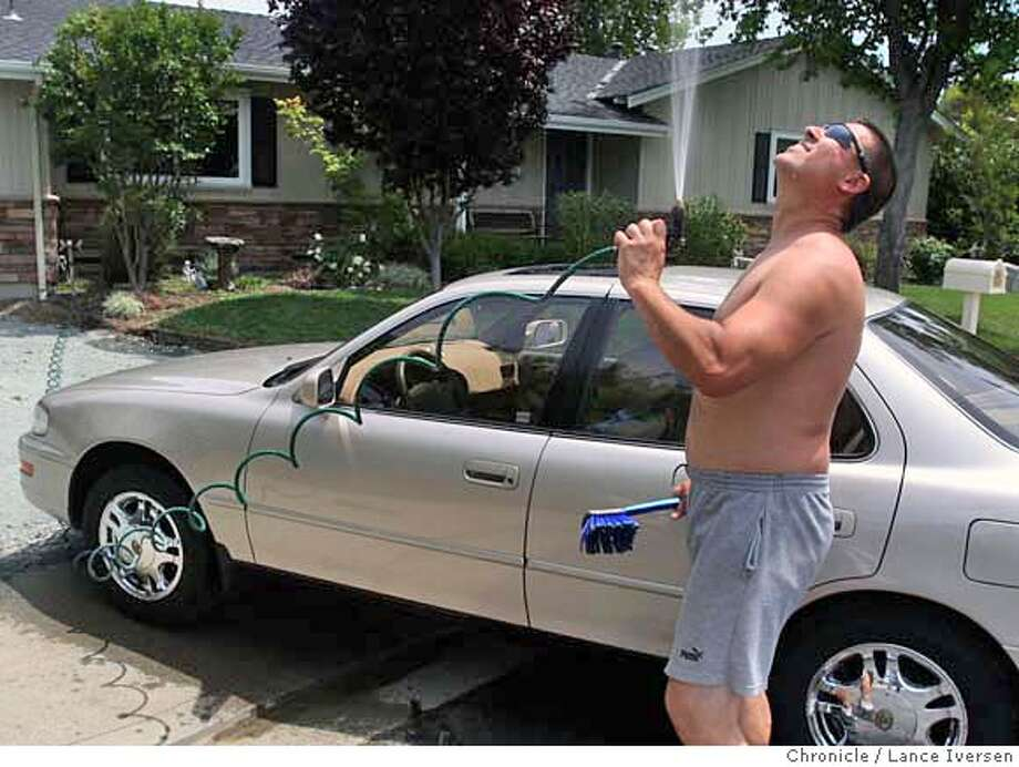 ###Live Caption:Scott Vaisnor cools off while washes his car at his Pleasant Hill home Wednesday May 14, 2008. EBMUD was the first water agency to approve water restrictions on Residents from Berkeley to Danville. Photographed in Pleasant Hill, Calif, By Lance Iversen / San Francisco Chronicle.###Caption History:Scott Vaisnor cools off while washes his car at his Pleasant Hill home Wednesday May 14, 2008. EBMUD was the first water agency to approve water restrictions on Residents from Berkeley to Danville. Photographed in Pleasant Hill, Calif, By Lance Iversen / San Francisco Chronicle.###Notes:Lance Iversen 415-2979395  CQ###Special Instructions:MANDATORY CREDIT PHOTOG AND SAN FRANCISCO CHRONICLE. Photo: LANCE IVERSEN