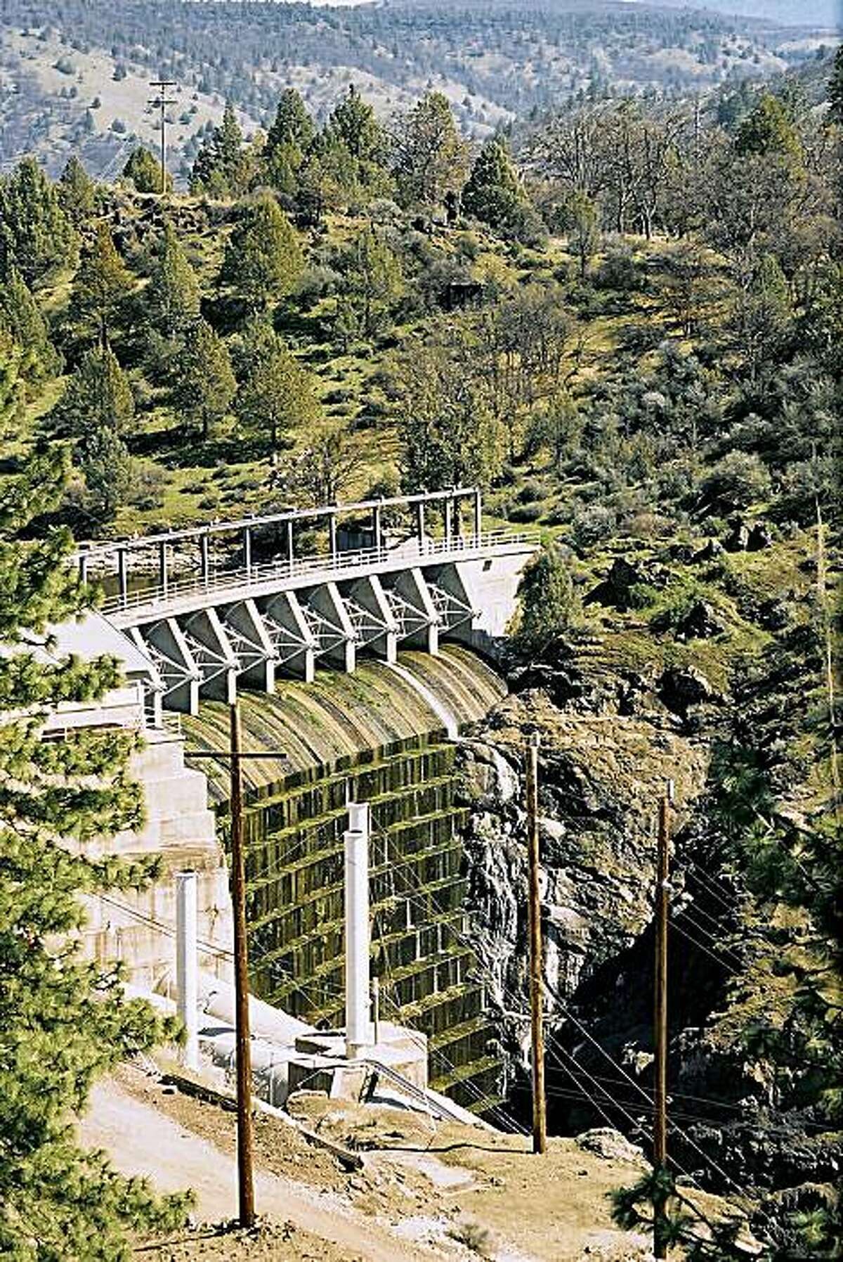 A file photo shows the Copco No. 1 dam operated by PacifCorp on the Klamath River outside Hornbrook, Calif., on March 16, 2004. Warren Buffett's MidAmerican Energy Holdings Co., which provides power for 5 million customers worldwide and is the largest utility in Iowa, is acquiring PacifiCorp, an electric utility with customers in six Western states, for $5.1 billion in cash, it was announced Tueday May 24, 2005. (AP Photo/Jeff Barnard)