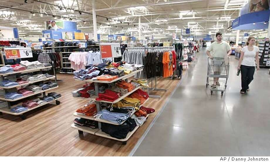 ###Live Caption:This week, several big retailers — Wal-Mart Stores Inc., Macy's Inc. and JCPenney Co. — release their first-quarter results, along with outlooks for lat?  er in the year.###Caption History:In this April 29, 2008, photo, shoppers stroll the aisles in a Maumelle, Ark., Wal-Mart Stores Inc., Supercenter store. Wal-Mart, which is rolling out more discounts, reported a 3.2 percent gain in April in same-store sales. (AP Photo/Danny Johnston)###Notes:###Special Instructions:APRIL 29 2008 PHOTO Photo: Danny Johnston