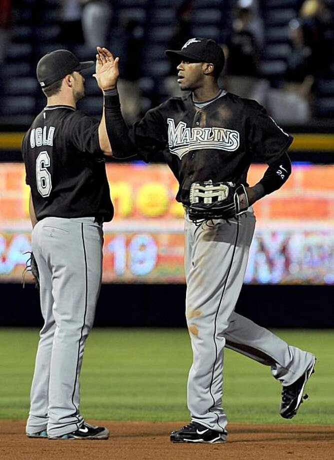 Florida Marlins' Cameron Maybin, right celebrates with Marlins' Dan Uggla (6) after the Marlins' 5-4 win against the Atlanta Braves after a baseball game Tuesday, Sept. 29, 2009, at Turner Field in Atlanta. (AP Photo/Gregory Smith) Photo: Gregory Smith, AP