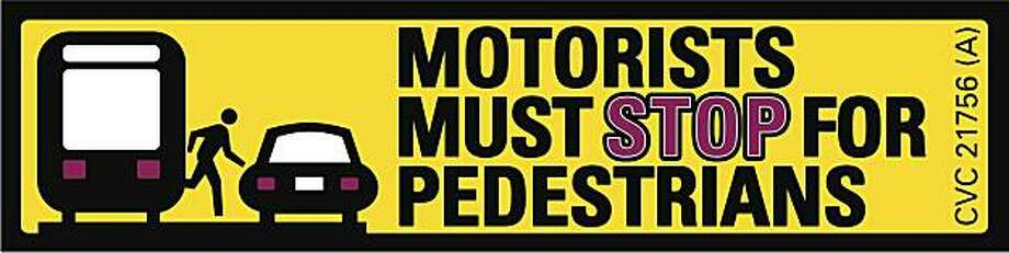 Pedestrian-safety warning stickers for Muni trains. Photo: SFMTA