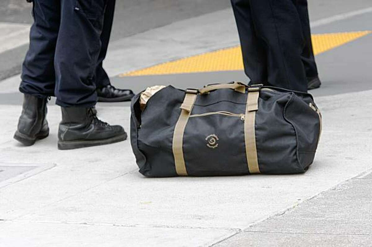 At the Transbay Terminal, San Francisco Police Officers watch over a harmless gym bag a bus drive found it on the bus on Monday Sep. 28, 2009 in San Francisco, Calif. The bomb squad later determined it to be harmless.