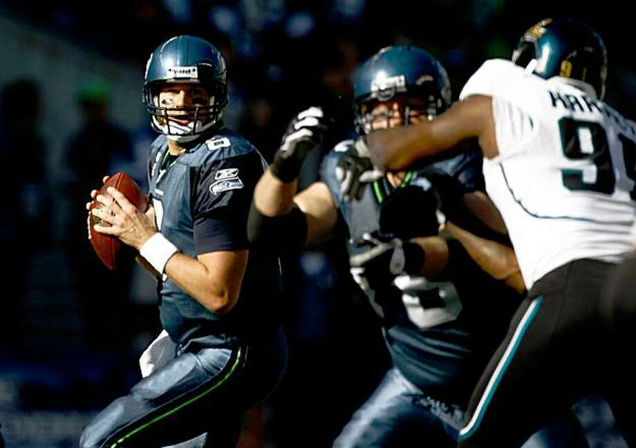 SEATTLE, WA - OCTOBER 11:  Quarterback Matt Hasselbeck #8 of the Seattle Seahawks looks to throw the ball against the Jacksonville Jaguars at Qwest Field on October 11, 2009 in Seattle, Washington.  (Photo by Jonathan Ferrey/Getty Images) Photo: Jonathan Ferrey, Getty Images