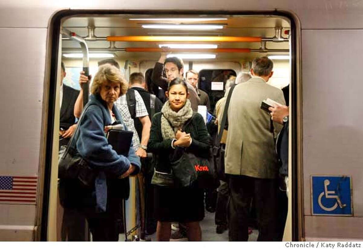 Commuters at Embarcadero Station crowd into a BART car. BART trains are being reconfigured to pack in more commuters by removing some seats and adding hanging hold straps. Katy Raddatz / The San Francisco Chronicle