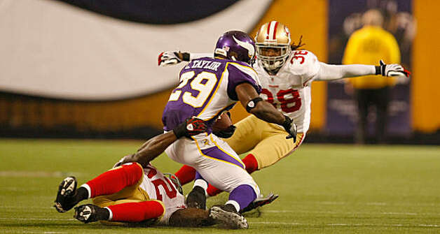 San Francisco 49ers Dashon Goldson blocks and stops Minnesota Viking, Chester Taylor after Taylor makes a first down, Sunday Sept. 27, 2009, in Minneapolis,  Minnesota Photo: Lacy Atkins, The Chronicle