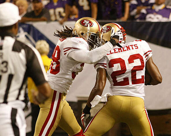 San Francisco 49ers Dashon Goldson and Nate Clements react as Clement crosses the goal line for a touchdown running 59 yards after blocking a field goal in the second quarter, against the Minnesota Vikings, Sunday Sept. 27, 2009, in Minneapolis, Minnesota. Photo: Lacy Atkins, The Chronicle