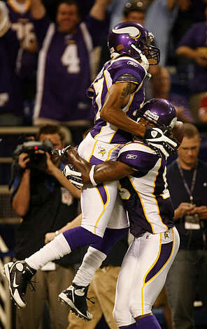 Minnesota Vikings Greg Lewis is picked up by Sidney Rice after making the winning touchdown in the last seconds of the game,  Sunday Sept. 27, 2009, in Minneapolis,  Minnesota. Photo: Lacy Atkins, The Chronicle