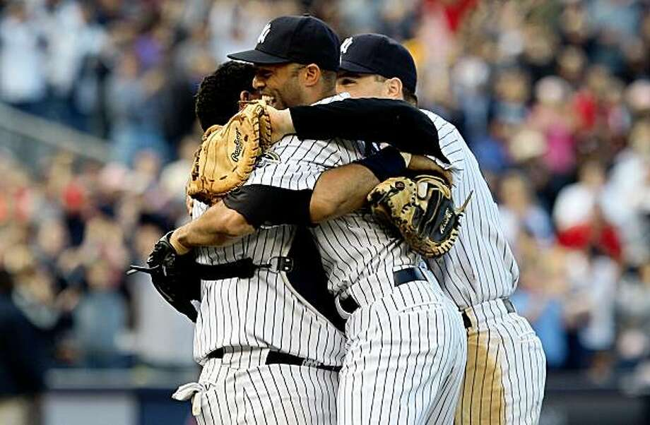 NEW YORK - SEPTEMBER 27:  Mariano Rivera #42 of the New York Yankees celebrates after his team defeated the Boston Red Sox with teammate Jose Molina (L) and Mark Teixeira #25 on September 27, 2009 at Yankee Stadium in the Bronx borough of New York City. The Yankees won the game 4-2 to earn their 100th win of the season as well as clinching the American League Eastern Division.  (Photo by Jim McIsaac/Getty Images) Photo: Jim McIsaac, Getty Images