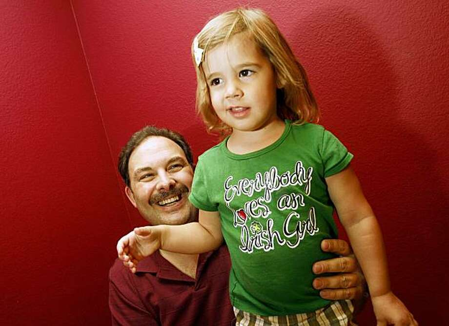 In this photo made Sept. 29, 2009, Joe Nesbitt, 44, and his daughter Helen, 3, are pictured at their home in Henderson, Nev. Nesbitt used a Brickhouse Child Locator when he was separated from his daughter while vacationing at Sea World. (AP Photo/Isaac Brekken) Photo: Isaac Brekken, AP
