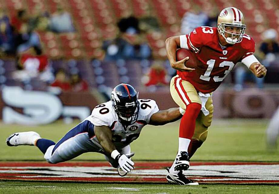 Shaun Hill escapes from Denver's Kenny Peterson for a nine-yard gain in the first quarter of the San Francisco 49ers vs. Denver Broncos pre-season football game at Candlestick Park in San Francisco, Calif., on Friday, Aug. 14, 2009. Photo: Paul Chinn, The Chronicle
