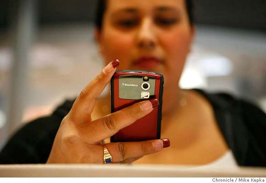 ###Live Caption:At the AT&T store on Mission Street, Sophia Reyes of San Francisco, Calif. types in her passcode on her blackberry on Monday April, 29, 2008 in San Francisco, Calif. Reyes says she uses her phone to send and receive email everyday.  Photo by Mike Kepka / San Francisco Chronicle###Caption History:At the AT&T store on Mission Street, the Sophia Reyes of San Francisco, Calif. types in her passcode on her blackberry on Monday April, 29, 2008 in San Francisco, Calif. Reyes says she uses her phone to send and receive email everyday.  Photo by Mike Kepka / San Francisco Chronicle###Notes:(cq)###Special Instructions:MANDATORY CREDIT FOR PHOTOG AND SAN FRANCISCO CHRONICLE/NO SALES-MAGS OUT Photo: Kepka, Mike
