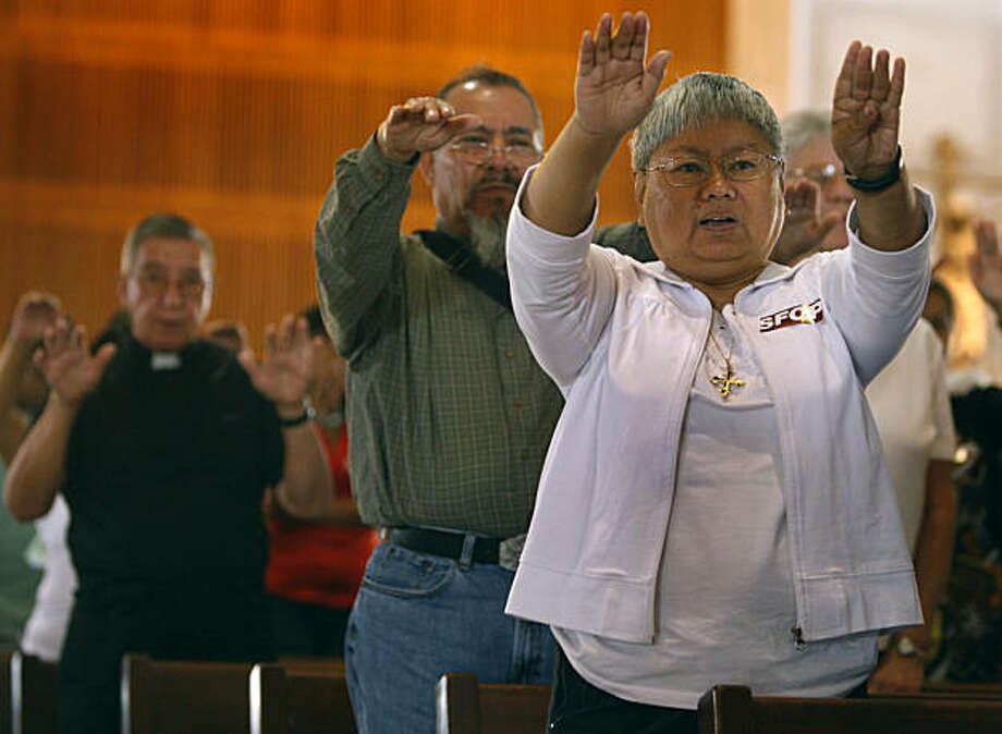 Joyce Calagos prays for immigration reform at St. Mary's Cathedral in San Francisco, Calif., on Saturday, Sept. 26, 2009. Photo: Paul Chinn, The Chronicle