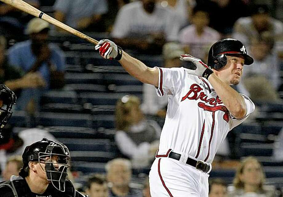Atlanta Braves' Chipper Jones hits a solo home run in the third inning against the Florida Marlins during a baseball game in Atlanta on Monday, Sept. 28, 2009. (AP Photo/The Atlanta Journal & Constitution,Curtis Compton)   ** MARIETTA DAILY OUT, GWINNETT DAILY POST OUT ** Photo: Curtis Compton, AP