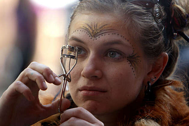 A last-minute eyelash curling before LovEvolution makes its way down Market Street to Civic Center Plaza in San Francisco on Saturday. Photo: Frederic Larson, The Chronicle