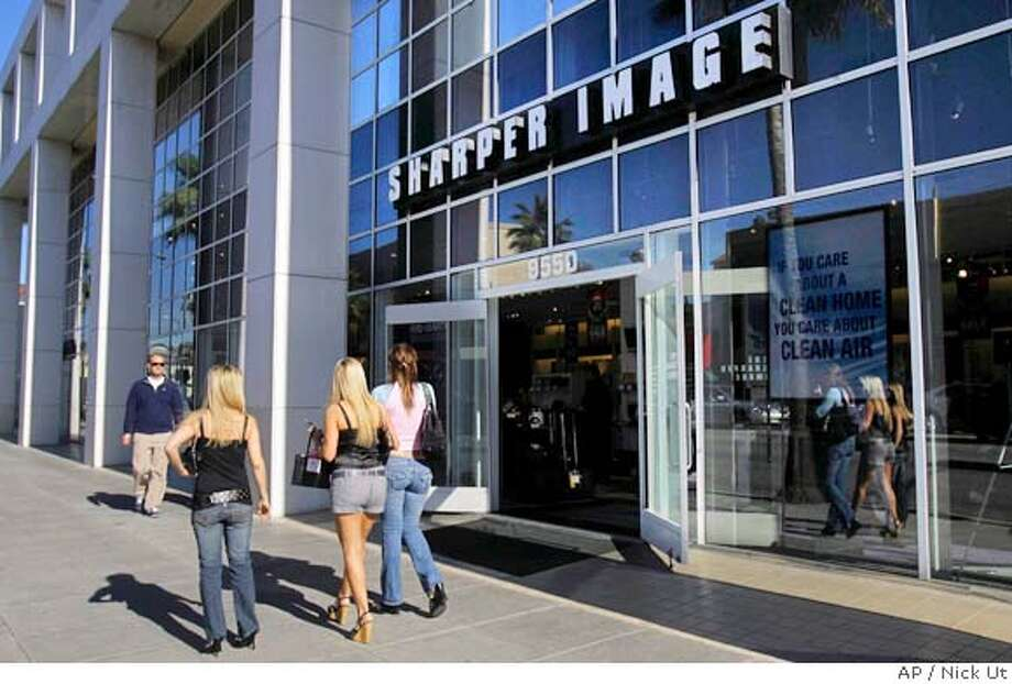 ** FILE ** Pedestrians walk by a Sharper Image store in Beverly Hills, Calif. in this Feb. 27, 2008 file photo. Veterans Affairs employees last year racked up hundreds of thousands of dollars in government credit-card bills at casino and luxury hotels, movie theaters and high-end retailers such as The Sharper Image and Franklin Covey - and government auditors are investigating, citing past spending abuses. (AP Photo/Nick Ut, File) Photo: Nick Ut