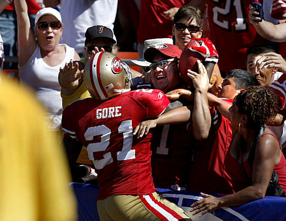 Frank Gore goes into the crowd briefly after his second touchdown of the 49ers home opener against the Seattle Seahawks on Sunday. Photo: Brant Ward, The Chronicle