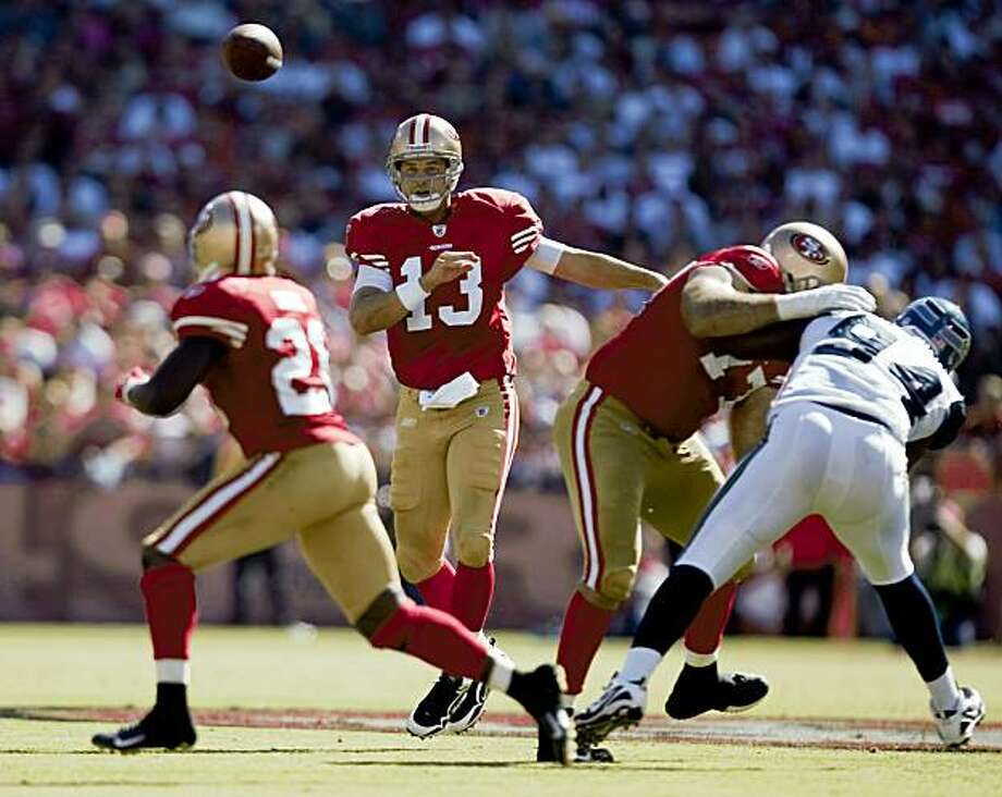 Quarterback Shaun Hill (13), center throws a pass to running back Frank Gore (21) in the fourth quarter against the Seattle Seahawks at Candlestick Park in San Francisco, Calif. on Sunday, Sept. 20, 2009. The 49ers defeated the Seahawks 23-10. Photo: Stephen Lam, The Chronicle