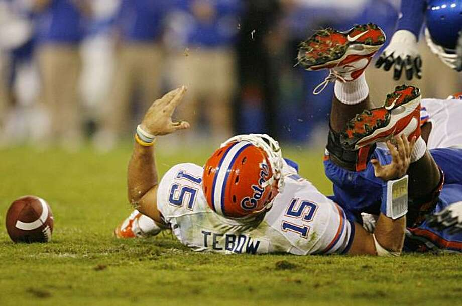 LEXINGTON, KY - SEPTEMBER 26: Quarterback Tim Tebow #15 of the Florida Gators lays on the ground after being sacked by Taylor Wyndham #94 of the Kentucky Wildcats during the third quarter of the game at Commonwealth Stadium on September 26, 2009 in Lexington, Kentucky. (Photo by Andy Lyons/Getty Images) Photo: Andy Lyons, Getty Images