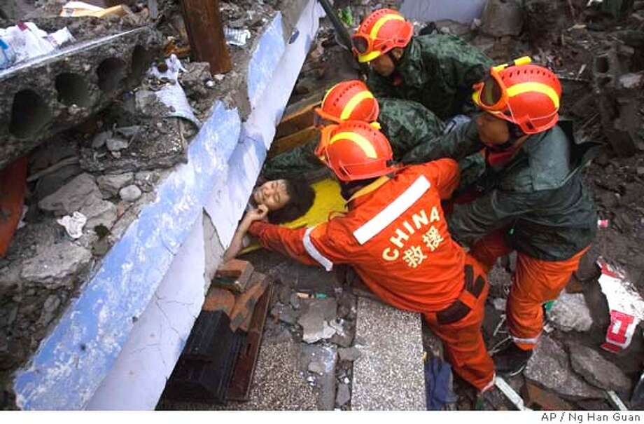 ###Live Caption:Rescue workers pull out a young girl from under the rubble of a collapsed school in Juyuan, southwestern China's Sichuan province, Tuesday, May 13, 2008. The death toll from a powerful earthquake in China that toppled buildings, schools and chemical plants climbed Tuesday to about 10,000, while untold numbers remained trapped after the country's worst quake in three decades. (AP Photo/Ng Han Guan)###Caption History:Rescue workers pull out a young girl from under the rubble of a collapsed school in Juyuan, southwestern China's Sichuan province, Tuesday, May 13, 2008. The death toll from a powerful earthquake in China that toppled buildings, schools and chemical plants climbed Tuesday to about 10,000, while untold numbers remained trapped after the country's worst quake in three decades. (AP Photo/Ng Han Guan)###Notes:###Special Instructions: Photo: Ng Han Guan