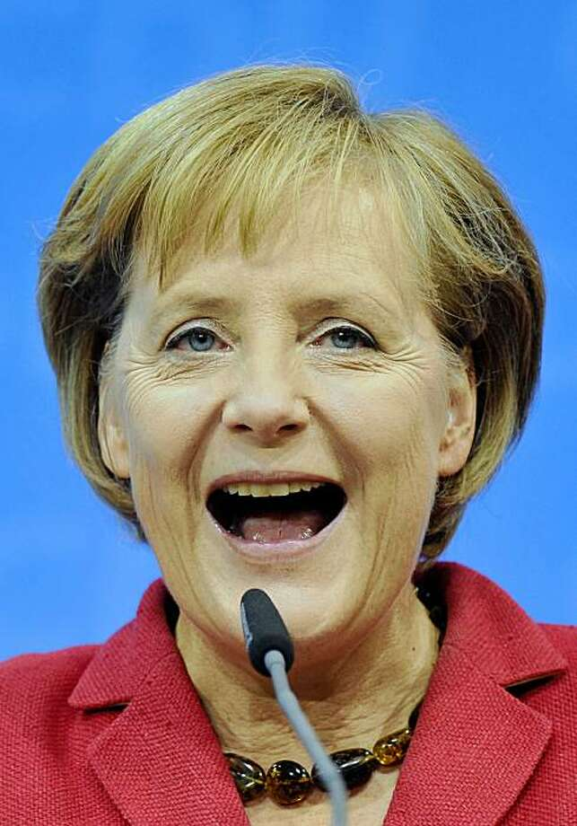 German Chancellor Angela Merkel of the Christian Democratic Party, CDU, reacts after the German general elections in Berlin, Sunday, Sept. 27, 2009. (AP Photo/Gero Breloer) Photo: Gero Breloer, AP