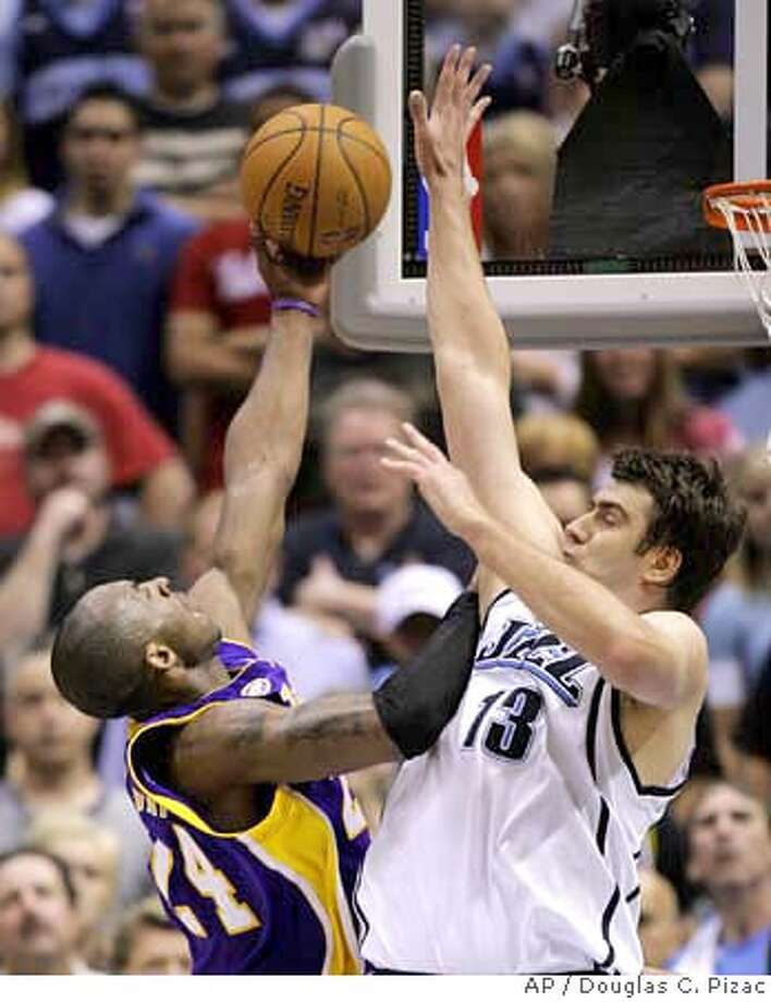 ###Live Caption:Utah Jazz forward Mehmet Okur (13), of Turkey, goes up to block Los Angeles Lakers guard Kobe Bryant (24) during overtime of Game 4 of the NBA basketball Western Conference semifinal series Sunday, May 11, 2008, in Salt Lake City. The Jazz beat the Lakers 123-115. (AP (AP Photo/Douglas C. Pizac)###Caption History:Utah Jazz forward Mehmet Okur (13), of Turkey, goes up to block Los Angeles Lakers guard Kobe Bryant (24) during overtime of Game 4 of the NBA basketball Western Conference semifinal series Sunday, May 11, 2008, in Salt Lake City. The Jazz beat the Lakers 123-115. (AP (AP Photo/Douglas C. Pizac)###Notes:Mehmet Okur, Kobe Bryant###Special Instructions:EFE OUT Photo: Douglas C. Pizac
