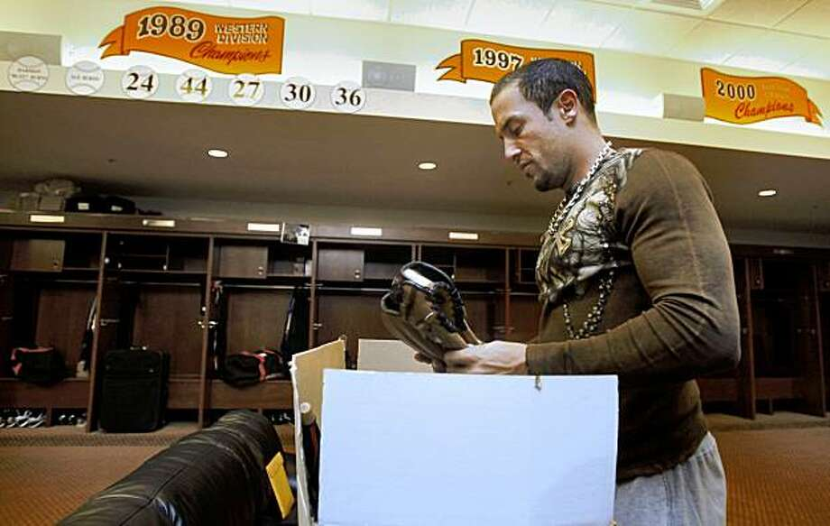 Andres Torres packs his gear at the clubhouse as the SF Giants season closes in San Francisco , Calif., on Monday, October 5, 2009. Photo: Liz Hafalia, The Chronicle