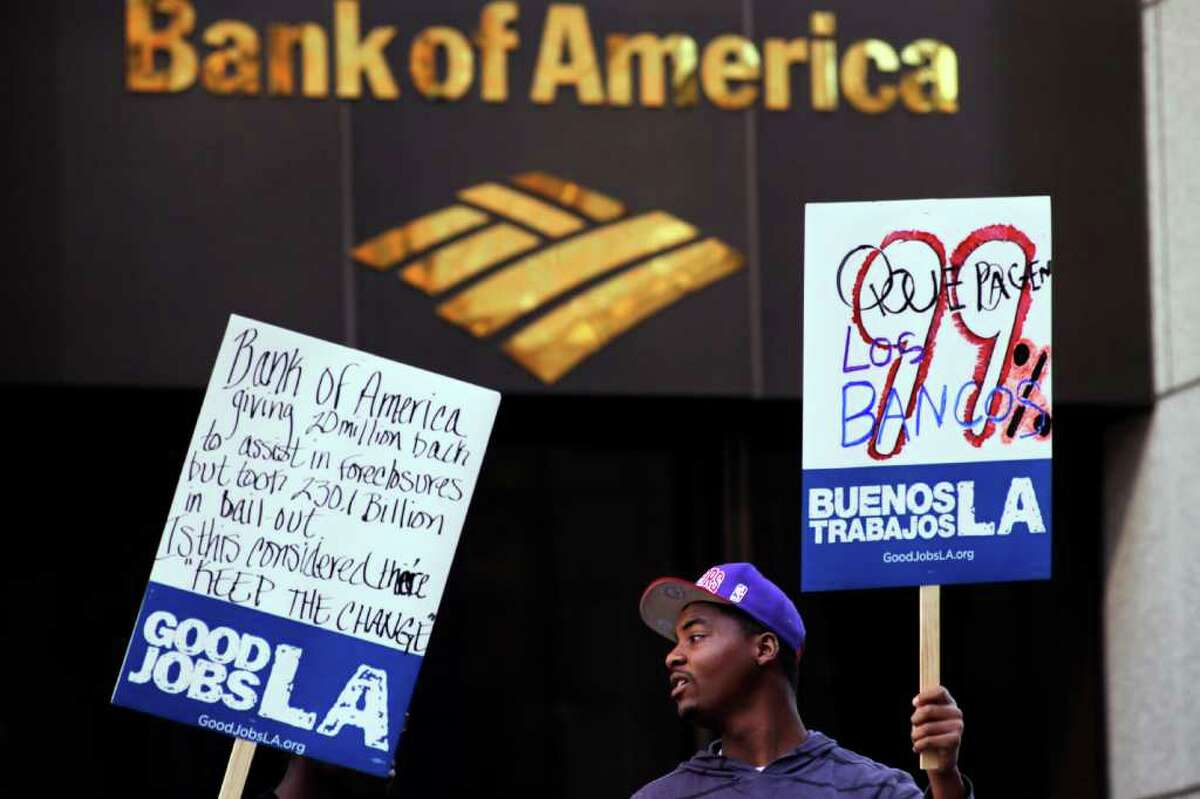 Occupy LA activists rally outside the Bank of America Plaza in Los Angeles on Thursday, Feb. 9, 2012. A landmark $25 billion settlement with the nation's top mortgage lenders was hailed by government officials Thursday as long-overdue relief for victims of foreclosure abuses. The settlement also ends a separate investigation into Bank of America and Countrywide for inflating appraisals of loans from 2003 through most of 2009.
