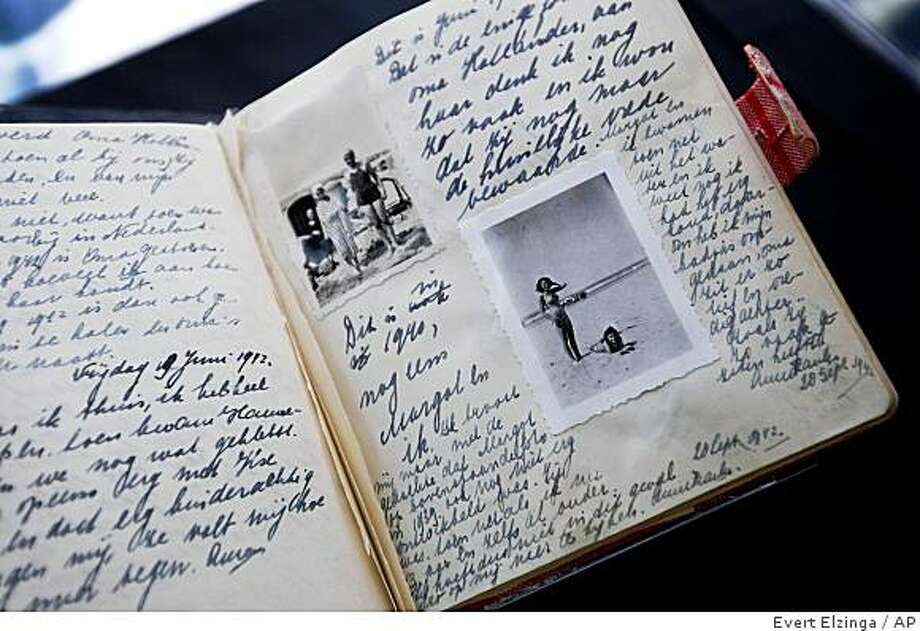 A facsimile of Anne Frank's diary displayed during a press conference at Anne Frank House in Amsterdam, Netherlands, Thursday, June 11, 2009. The Anne Frank House museum says it will permanently exhibit her diaries and other writings as part of activities commemorating the 80th anniversary of her birth on June 12, 1929. Frank died aged 15 in a concentration camp, but her posthumously published diary has made her a symbol of all Jews killed in World War II. Photo: Evert Elzinga, AP