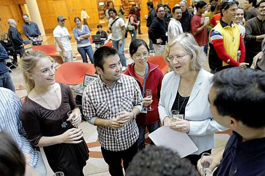 Scientist Elizabeth H. Blackburn, PhD, 60, of the University of California, San Francisco, shares a moment with her lab colleagues after she was named to receive the 2009 Nobel Prize in Physiology or Medicine on Monday, October 5, 2009. Blackburn shares the award with Carol W. Greider of Johns Hopkins University School of Medicine and Jack W. Szostak of Harvard Medical School. Photo: Carlos Avila Gonzalez, The Chronicle
