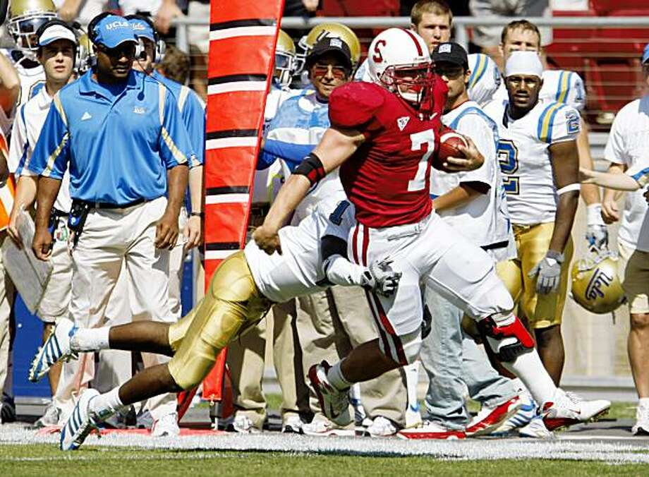 Stanford running back Toby Gerhart (7) is tackled by UCLA cornerback Alterraun Verner (1) during the first quarter of an NCAA football game in Stanford, Calif., Saturday, Oct. 3, 2009. Stanford defeated UCLA 24-16.  (AP Photo/Paul Sakuma) Photo: Paul Sakuma, AP