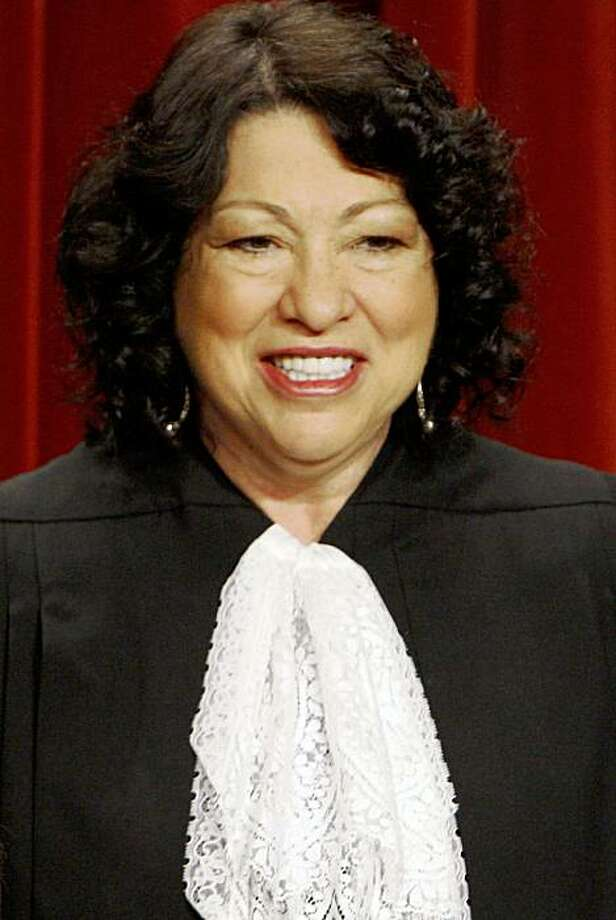 ** ADVANCE FOR SUNDAY, OCT. 4 AND THEREAFTER ** FILE - In this Sept. 29, 2009 file photo, the newest Supreme Court member, Justice Sonia Sotomayor, poses with her colleagues at the Supreme Court in Washington. (AP Photo/Charles Dharapak) Photo: Charles Dharapak, AP