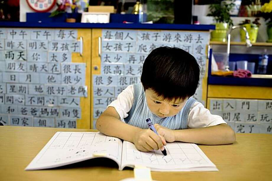 Ryan Luu, 4, a kindergarten student at West Portal Elementary School, works on Chinese characters in the Chinese immersion program, which celebrates the 25th anniversary, in San Francisco, Ca., on Friday, Sept. 11, 2009. Since then, many Chinese programs have opened in the city and the country. Photo: Lianne Milton, Special To The Chronicle