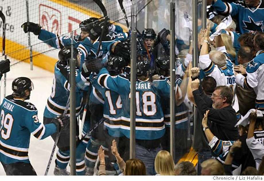 ###Live Caption:Sharks celebrate the winning goal in overtime as San Jose Sharks host Dallas Stars at HP Pavilion in San Jose, Calif., on Friday, May 2, 2008. Photo by Liz Hafalia / San Francisco Chronicle###Caption History:Sharks celebrate the winning goal in overtime as San Jose Sharks host Dallas Stars at HP Pavilion in San Jose, Calif., on Friday, May 2, 2008. Photo by Liz Hafalia / San Francisco Chronicle###Notes:Sharks celebrate the winning goal in overtime as San Jose Sharks host Dallas Stars at HP Pavilion in San Jose, Calif., on Friday, May 2, 2008. Liz Hafalia / The Chronicle / {city }###Special Instructions:�2008, San Francisco Chronicle/ Liz Hafalia  MANDATORY CREDIT FOR PHOTOG AND SAN FRANCISCO CHRONICLE. NO SALES- MAGS OUT. Photo: Liz Hafalia
